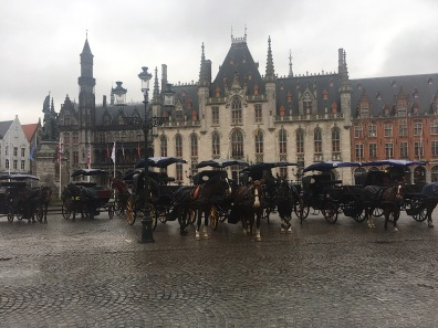Horses on the main square in Bruges